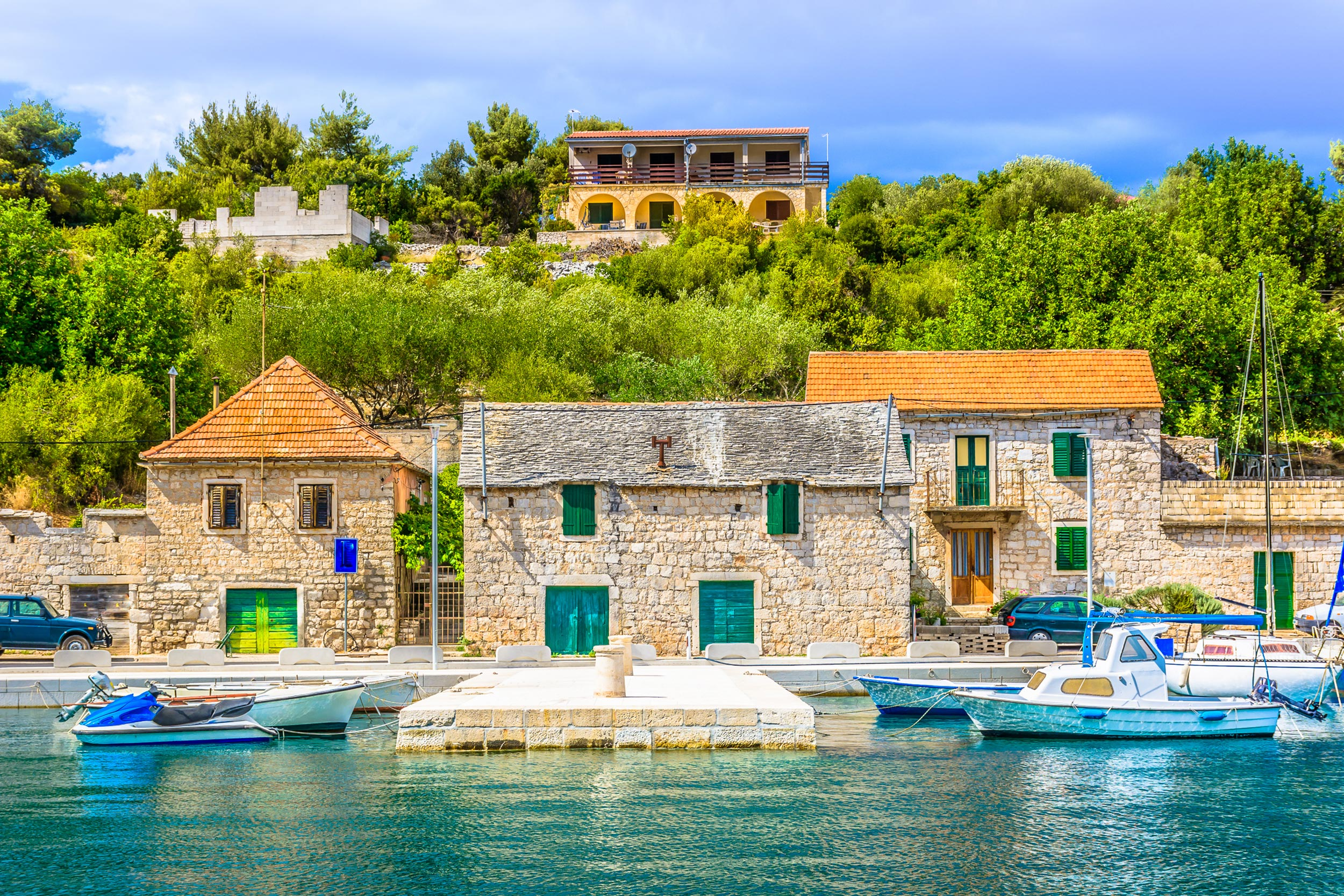 Old stone houses along the coast and small old boats