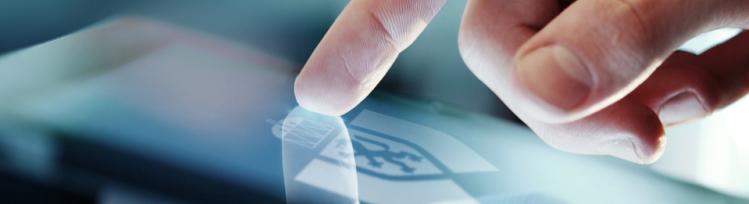Prst na ekranu s GRAWE logom