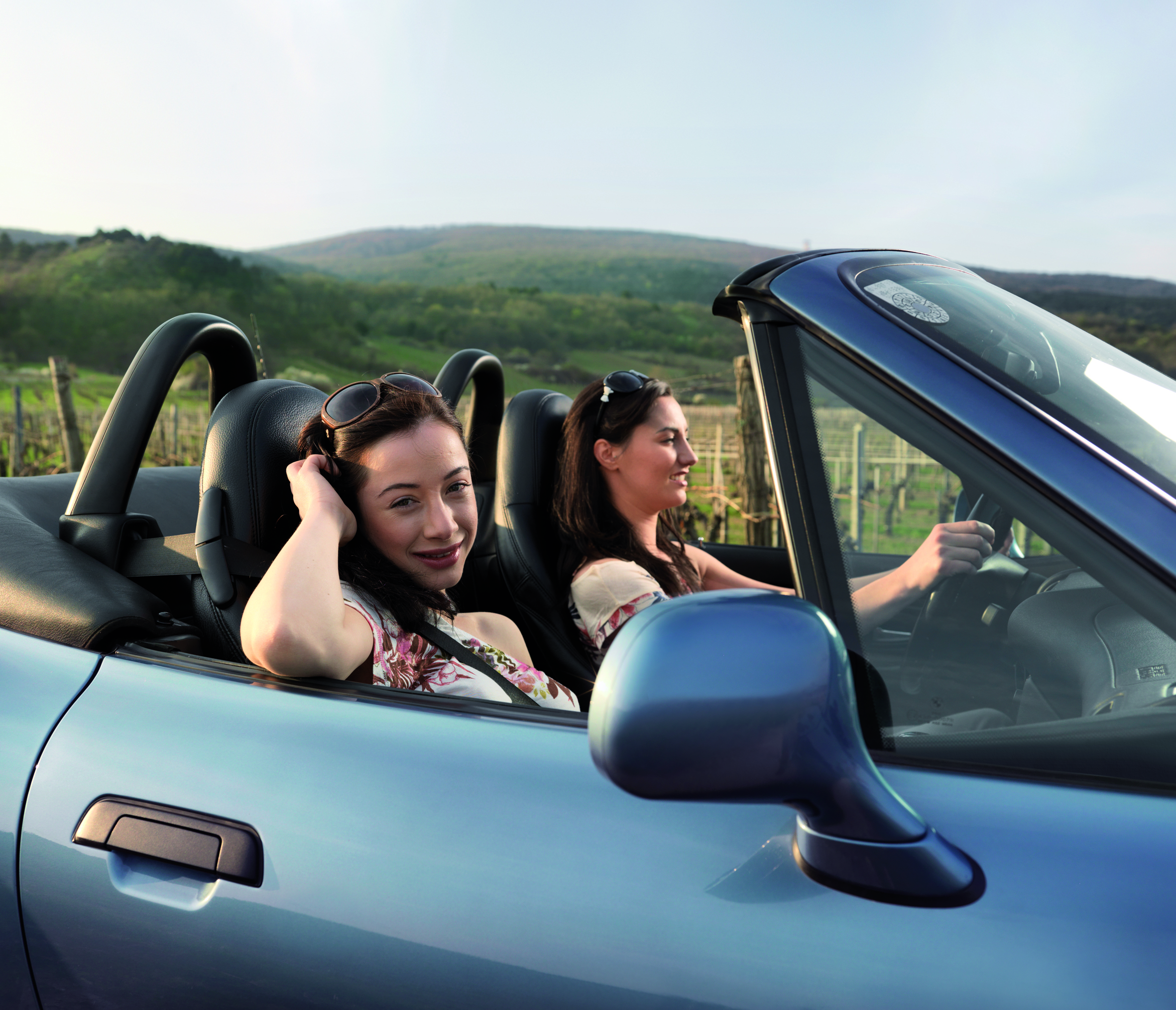 Two girls driving in a cabrio